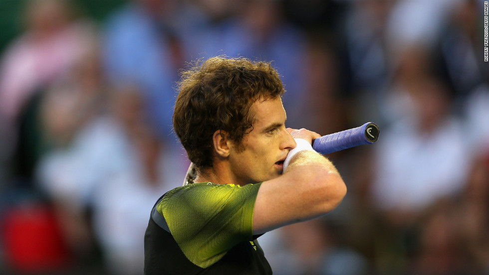 Andy Murray of Great Britain takes a breather in his semifinal match against Roger Federer of Switzerland on January 25.