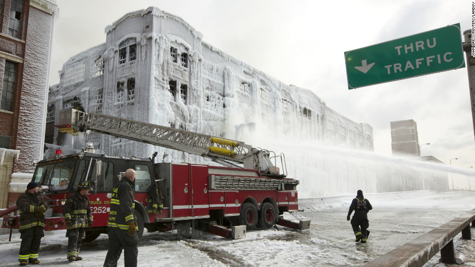 Firefighters battle a warehouse fire in Chicago on January 24.
