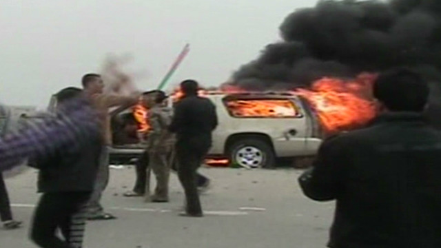 Iraqi soldiers fire on protesters.