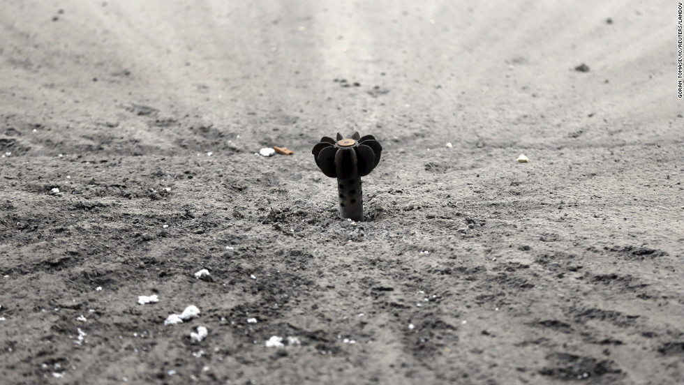An unexploded mortar shell fired by the Syrian army sits lodged in the ground in Damascus on Friday, January 25.
