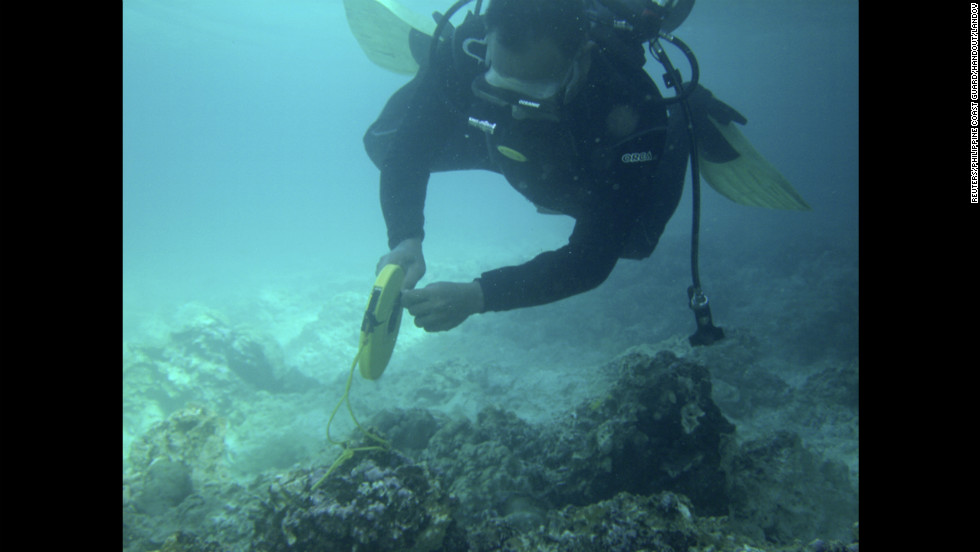 A diver from the Philippines coast guard measures coral damage on the Tubbataha Reef on January 22 in another handout photo. The reef is a Philippines national park and UNESCO World Heritage Site.