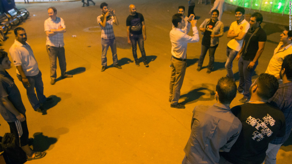 Fikra Space members experiment with Google Maps in a Baghdad park.