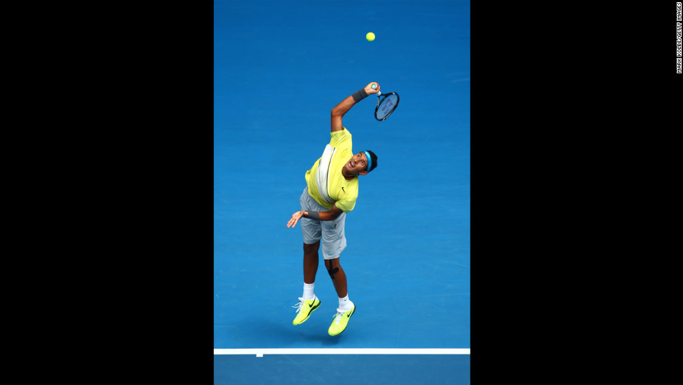 Nick Kyrgios of Australia serves in his junior boys' final match against Thanasi Kokkinakis of Australia on January 26. Kyrgios captured the boys singles title in straight sets.