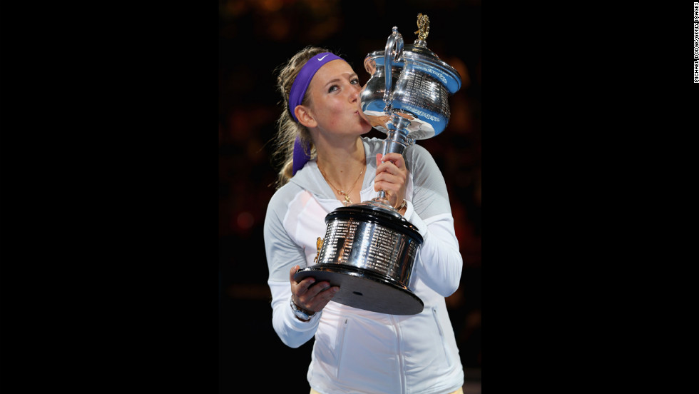Victoria Azarenka of Belarus poses with the winner's trophy after defending her Australian Open title on Saturday, January 26. Azarenka defeated Na Li of China 4-6, 6-4, 6-3.