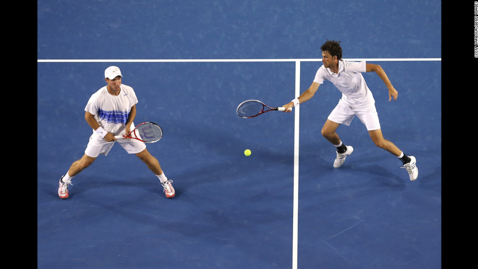 Robin Haase plays a forehand in Saturday's doubles match against the Bryan brothers.