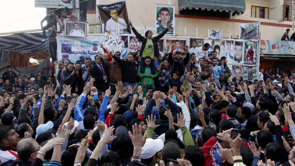 Protesters and fans of Al-Masry football club take part in a demonstration in front of the prison in Port Said.