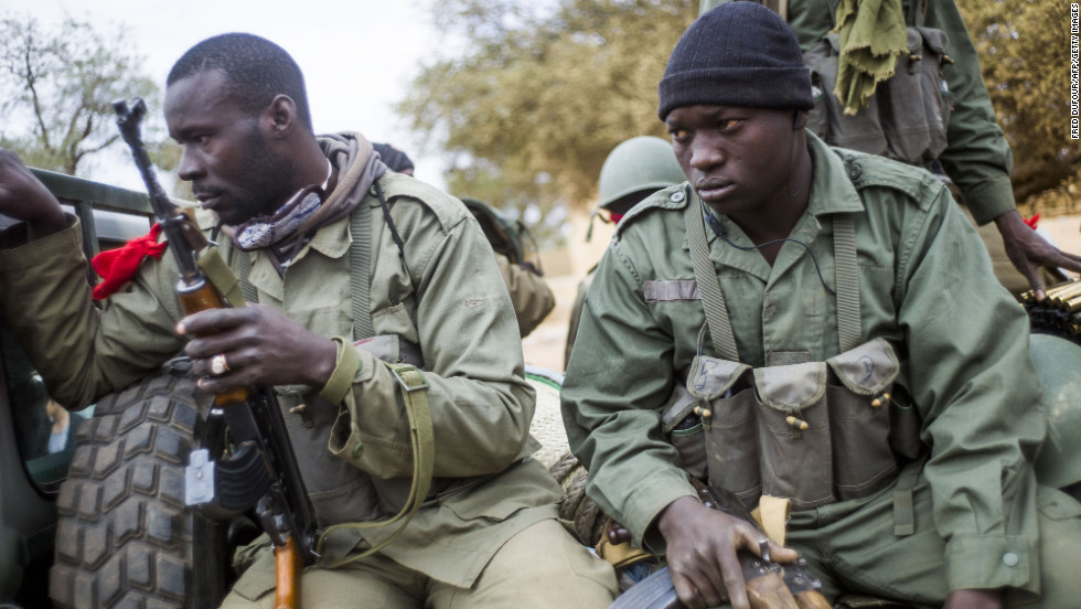 Malian soldiers wait at a checkpoint near Sevare on January 27.
