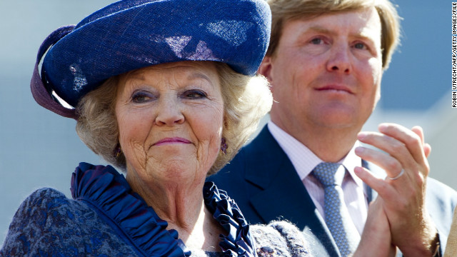 Queen Beatrix (L) and Prince Willem-Alexander of the Netherlands look on during Queen's Day in Veenendaal, Holland on  April 30, 2012.