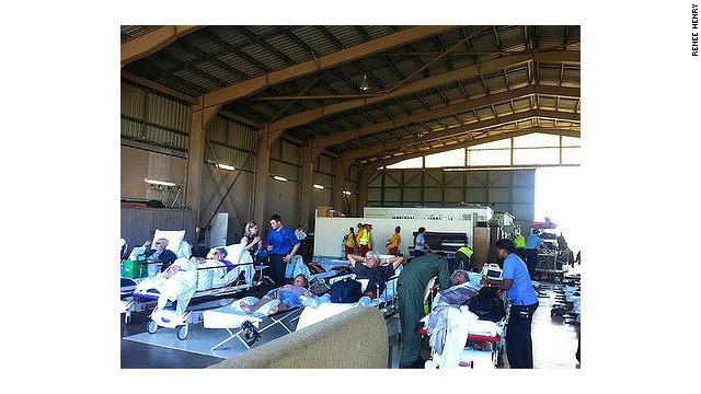 Patients from flood-hit Bundaberg hospital wait to be airlifted to safety