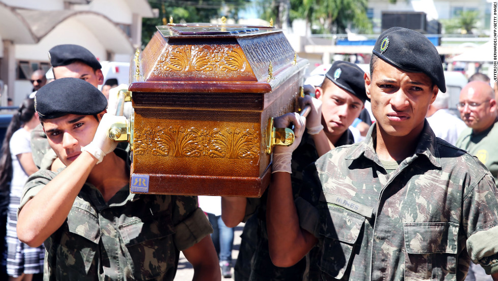 Soldiers carry the coffin of a victim of the nightclub blaze on January 28.