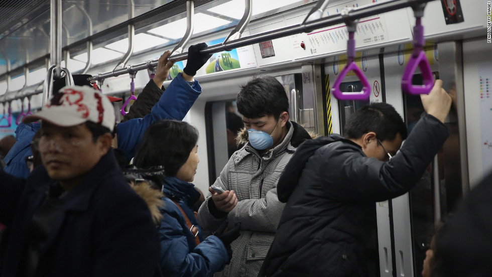 People ride the Beijing subway on January 23.