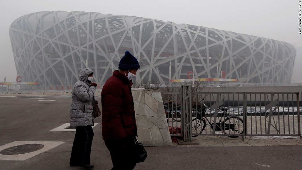 Beijing residents walk by the Bird Nest in Olympic Park on January 29.