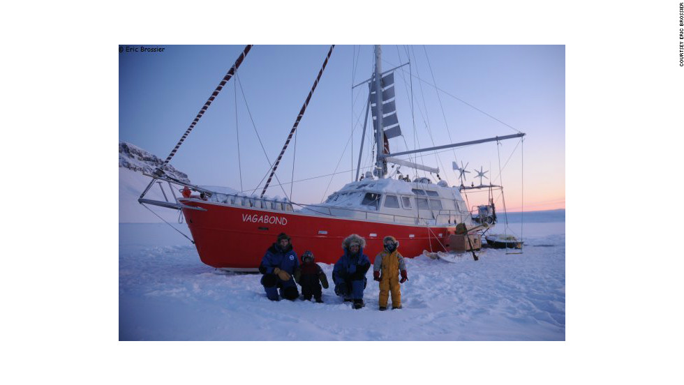 The Brossier family wrap up warm in front of their yacht, <em>Le Vagabond</em>. The family have spent the last eight winters living and carrying out research work in the northern polar regions.