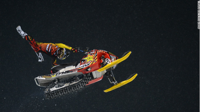 A photo of Caleb Moore's performance in the Snowmobile Freestyle Final during X Games Aspen 2013.
