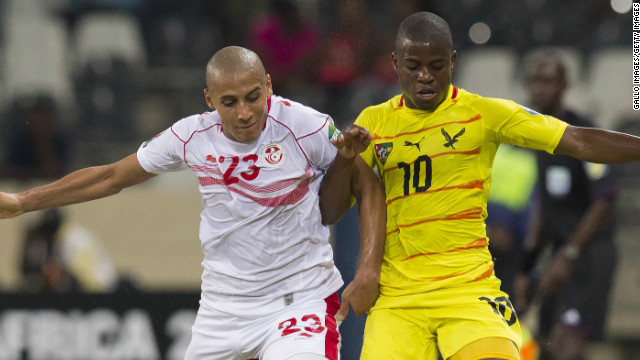 Wahbi Khazri of Tunisia and Floyd Ama Ayite of Togo do battle during the Africa Cup of Nations clash in Nelspruit.