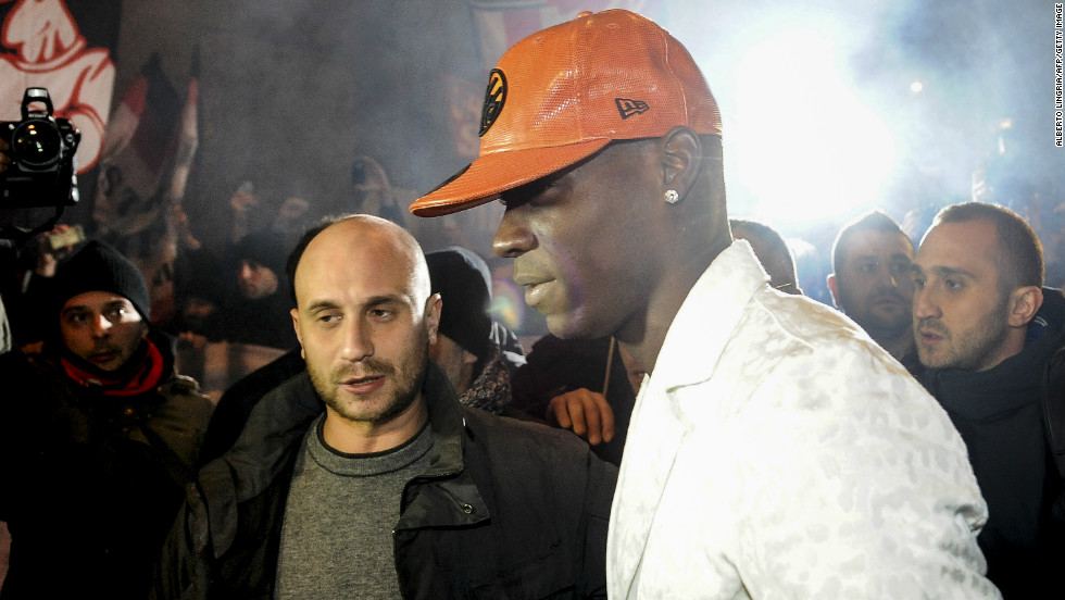 Mario Balotelli was mobbed by fans outside a restaurant as he returned home to Italy to complete his $30 million move from AC Milan to Manchester City.