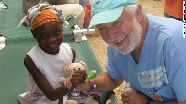 Dr. James Macdonald, here with a young patient in Haiti, runs a health clinic in Port-au-Prince that focuses on wound care.