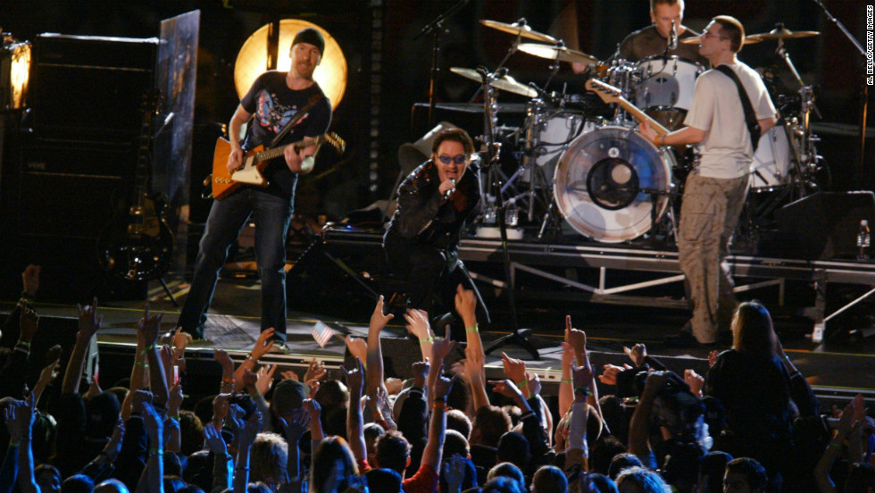 "At the first Super Bowl after September 11, U2 performed a tribute to those lost in the attacks. As the band played ""MLK,"" the names of victims appeared on a screen. The show ended with a stirring version of ""Where the Streets Have No Name,"" and Bono revealing the American flag in the lining of his jacket."