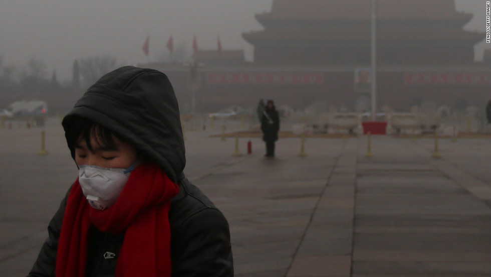 "A pedestrian wears a mask at Tiananmen Square as protection from severe pollution on Thursday, January 31, 2013, in Beijing. It's the fourth time this year that a heavy blanket of smog has affected eastern China, including the capital. The air quality has reached hazardous levels, and residents were encouraged to avoid outdoor activities. <a href=""http://edition.cnn.com/video/#/video/world/2013/01/31/mr-beijing-smog.cnn"" target=""_blank"">Watch a video explaining the hazardous smog.</a>"