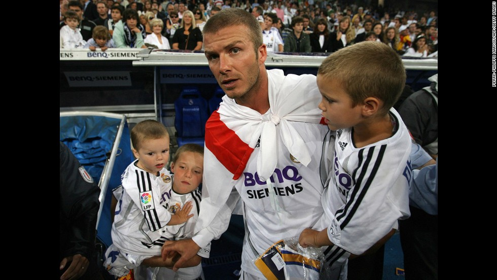 The midfielder celebrates with his sons in 2007 after Real Madrid won the Spanish League title by beating Mallorca.