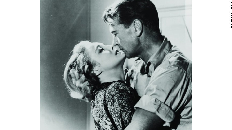 "Patricia Neal as Dominique Francon and Gary Cooper as Howard Roark in King Vidor's 1949 adaptation of Ayn Rand's ""The Fountainhead."""