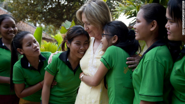 Girls hug U.S. Secretary of State Hillary Clinton during a 2010 tour of a shelter run for sex trafficking victims in Cambodia.