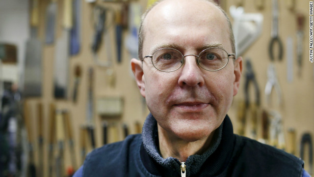Canadian-born furniture-maker Michael Ibsen, a direct descendant of the eldest sister of medieval British King Richard III, poses in his furniture workshop in London.