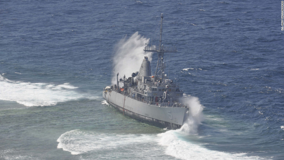 Waves crash against the USS Guardian in January. The minesweeper is estimated to have damaged 4,000 square meters of the Tubbataha Reef, a UNESCO World Heritage site.