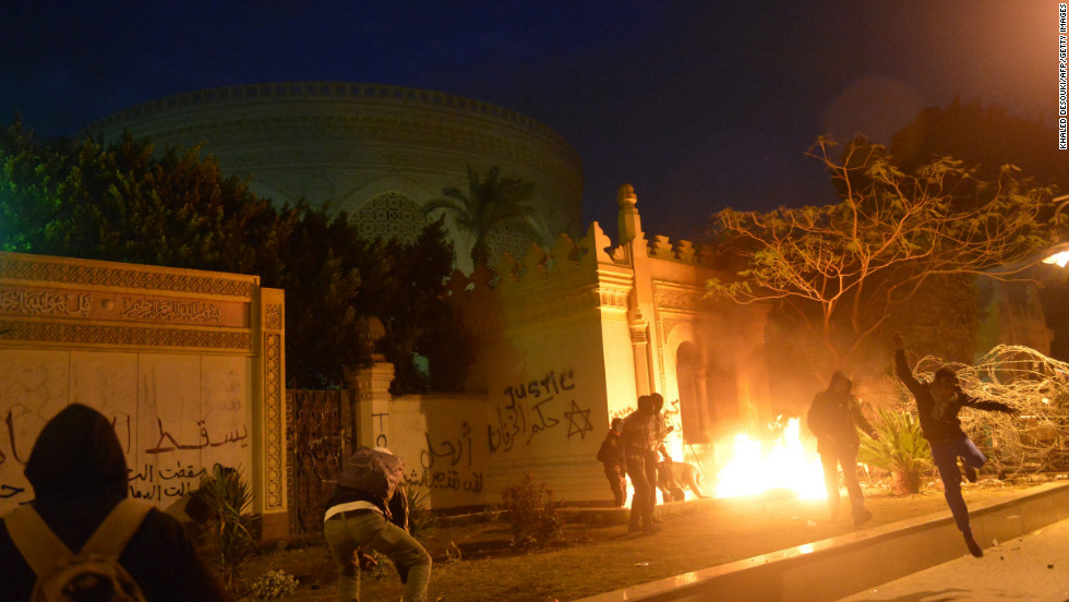 The entrance of Egypt's presidential palace in Cairo is in flames February 1, as protesters battle security forces.