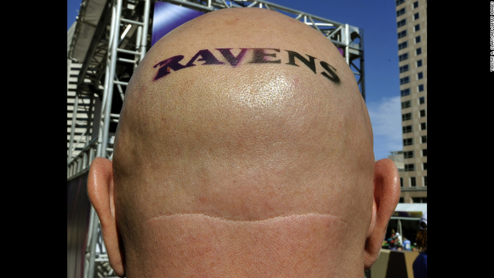 A Baltimore Ravens fan wears his heart on his scalp in New Orleans.