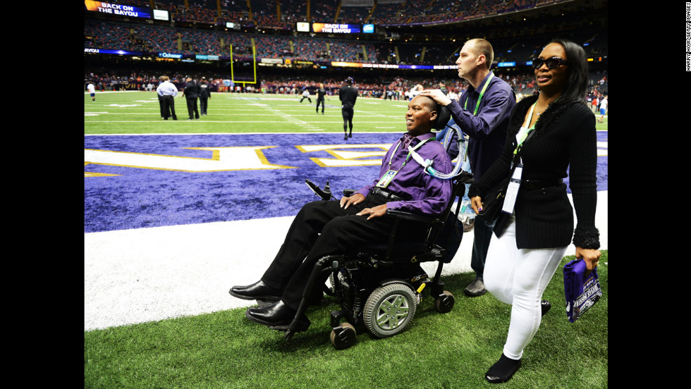 O.J. Brigance, left, senior player development adviser for the Baltimore Ravens, makes his way across the field with his wife, Chanda, prior to the start of Super Bowl XLVII. Brigance, a former Ravens player, was diagnosed with Lou Gehrig's disease in 2007.