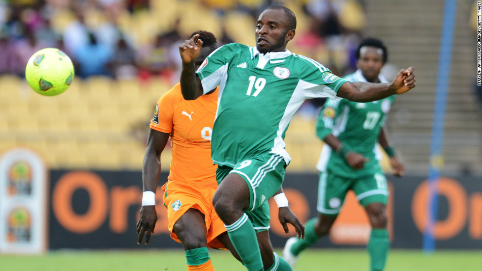 Cheick Tiote leveled for the tournament favorite but Sunday Mba's 78th-minute winner earned Nigeria a semifinal clash against Mali.