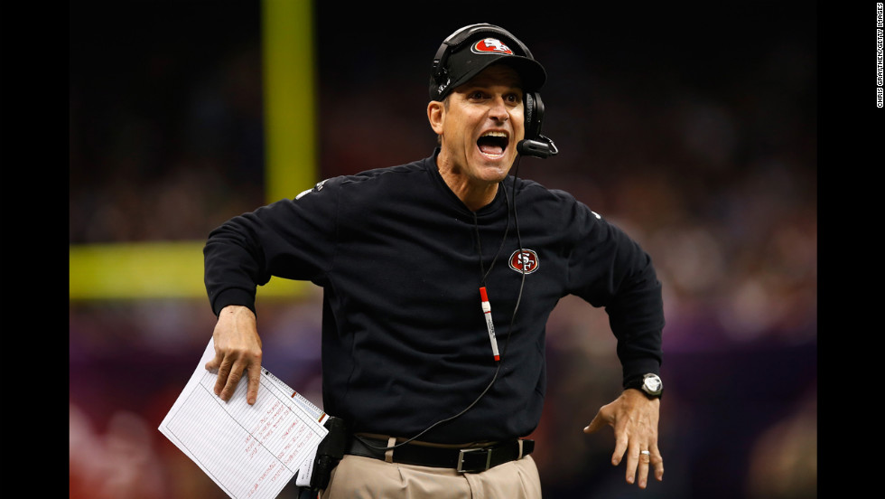49ers head coach Jim Harbaugh reacts to a play in the first quarter.