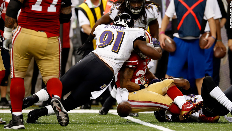 Courtney Upshaw of the Ravens forces LaMichael James of the 49ers to fumble in the second quarter.