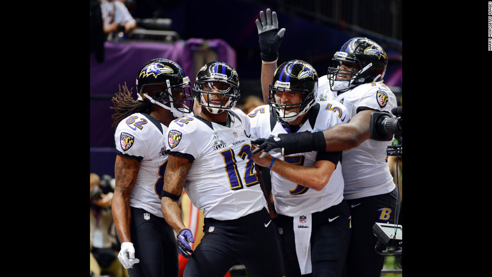 From left, Torrey Smith, Jacoby Jones, Joe Flacco and Kelechi Osemele of the Baltimore Ravens celebrate after Jones scored on a 56-yard touchdown pass from Flacco.