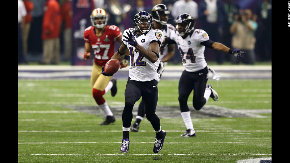 Jacoby Jones of the Baltimore Ravens runs the second-half kickoff back 108 yards for a touchdown.