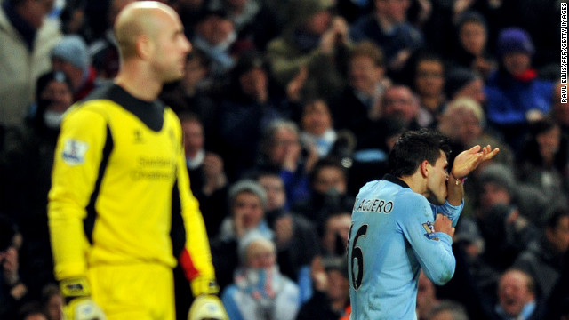 Manchester City's Argentina striker Sergio Aguero (right) celebrates scoring the equalizer at home to Liverpool on Sunday.