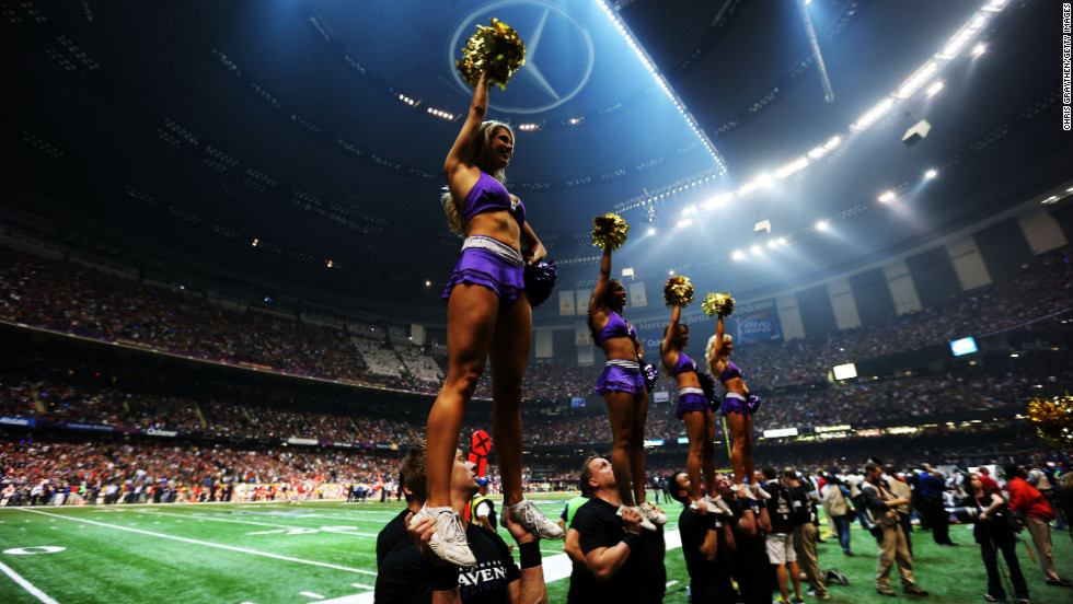 The Ravens' cheerleaders perform on the sidelines during the power outage.