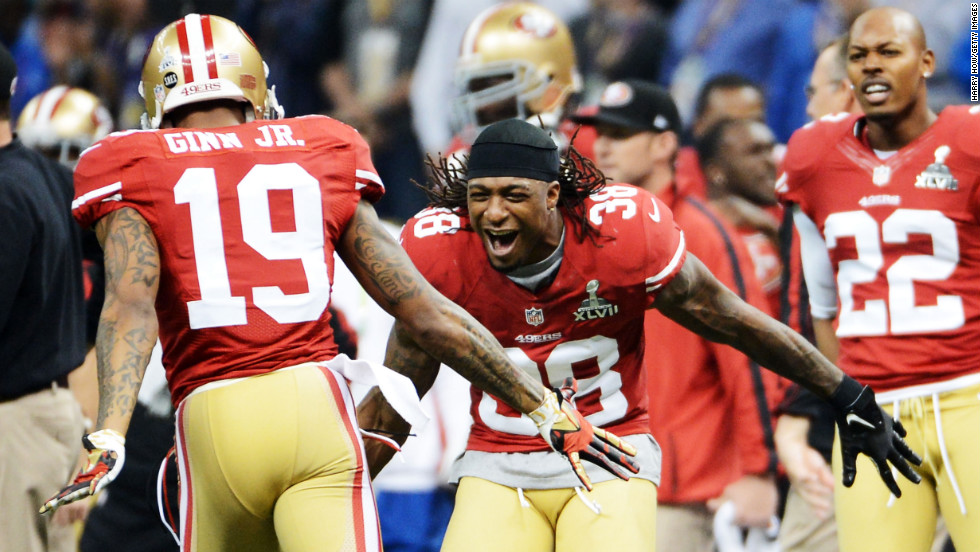 Ted Ginn Jr., left, of the San Francisco 49ers celebrates with teammate Dashon Goldson after a long punt return.