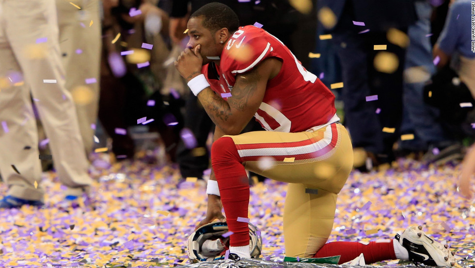 Cornerback Perrish Cox of the San Francisco 49ers kneels down among the confetti following his team's loss.