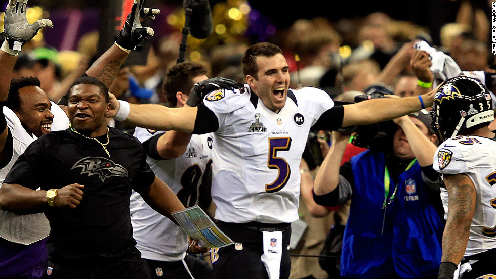 Super bowl MVP Joe Flacco of the Baltimore Ravens celebreates with his teammates.