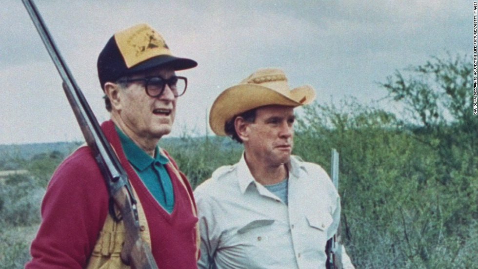 George H.W. Bush and oil heir William Farish check out a quail hunt at Lazy F Ranch in Texas in January 1989.