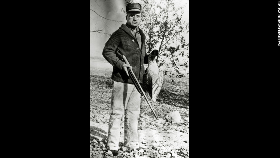 Harry S. Truman holds a bird on a hunting trip in Missouri in January 1930.
