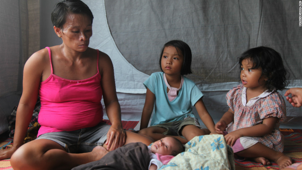 Lydia Inungam, 38, lives with her family in a tent after recently giving birth to her seventh child. Her village of wood and bamboo huts was flattened by the typhoon.