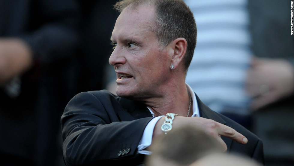 Gascoigne gestures as he watches a match between his former sides Newcastle and Tottenham at St James' Park.