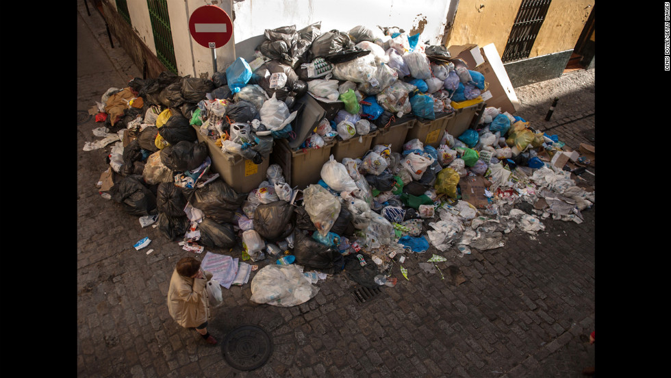 A large pile of garbage fills the corner of a street in Seville, Spain, on Wednesday, February 6.