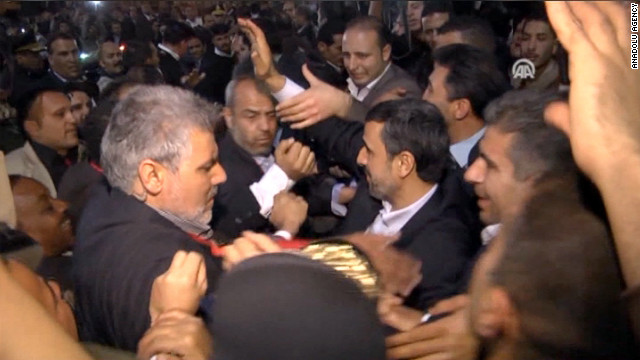During a historic trip to Egypt, Iranian President Mahmoud Ahmadinejad was greeted by a group of men who hurled shoes at him -- a major insult in the Muslim world.