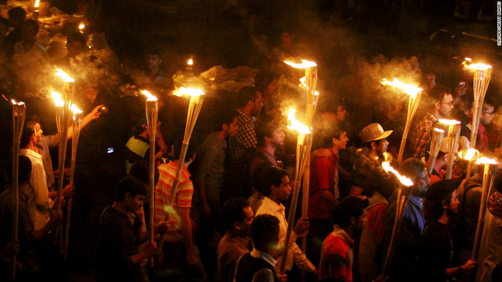Bangladeshi social activists and bloggers participate in a torch-lit rally on February 6 in Dhaka.