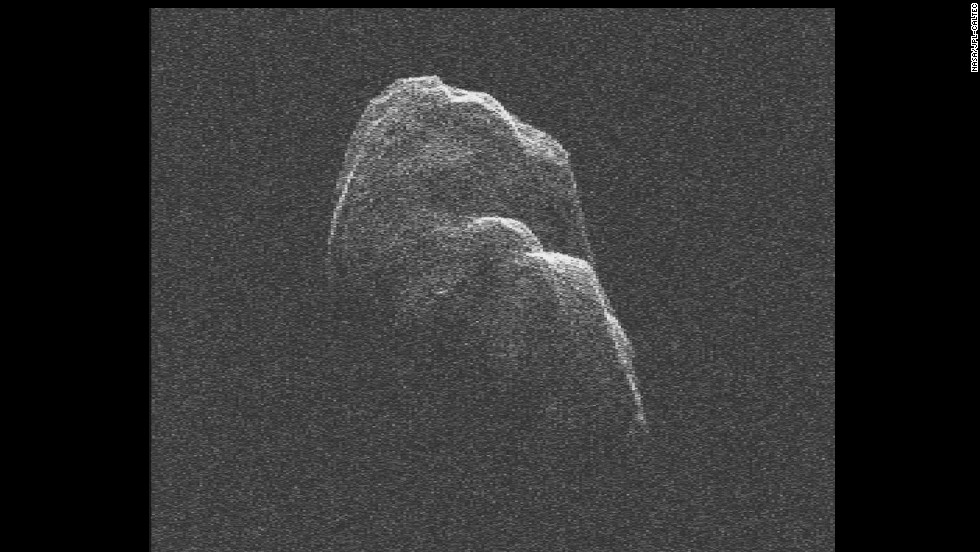 "The three-mile long (4.8-kilometer) asteroid Toutatis flew about 4.3 million miles (6.9 million kilometers) from Earth on December 12, 2012. NASA scientists used radar images to <a href=""http://www.youtube.com/watch?v=fo38qU00HlQ"" target=""_blank"">make a short movie</a>."