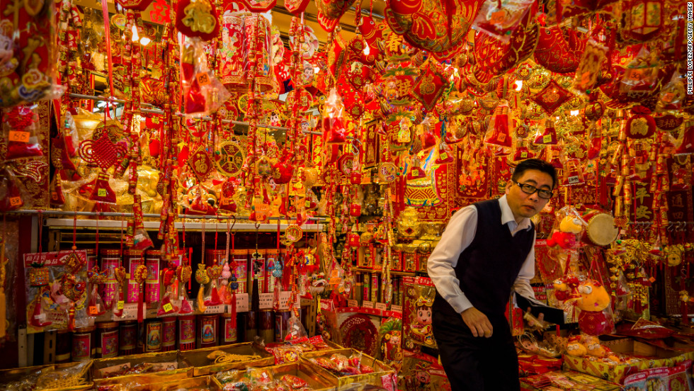 A man exits a shop selling Chinese New Year decorations in Hong Kong on Tuesday, February 5.